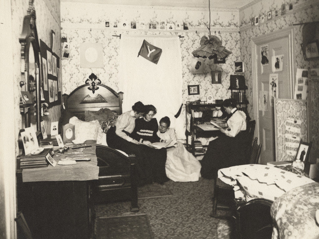 Four students in a Boarding House dorm room